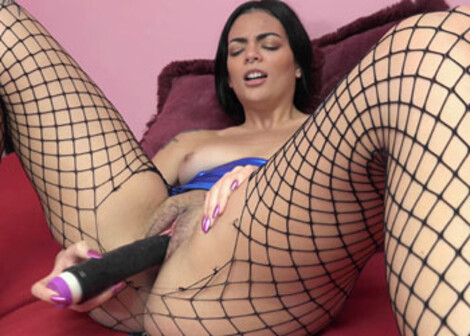 Mila fucks a dildo in her torn pantyhose